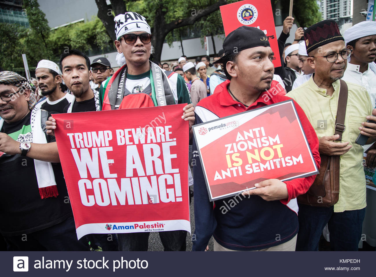 Kuala Lumpur, Malaysia. 8th Dec, 2017. Protester hold signs reading 'Trump beware we are coming' and 'Anti - Stock Image