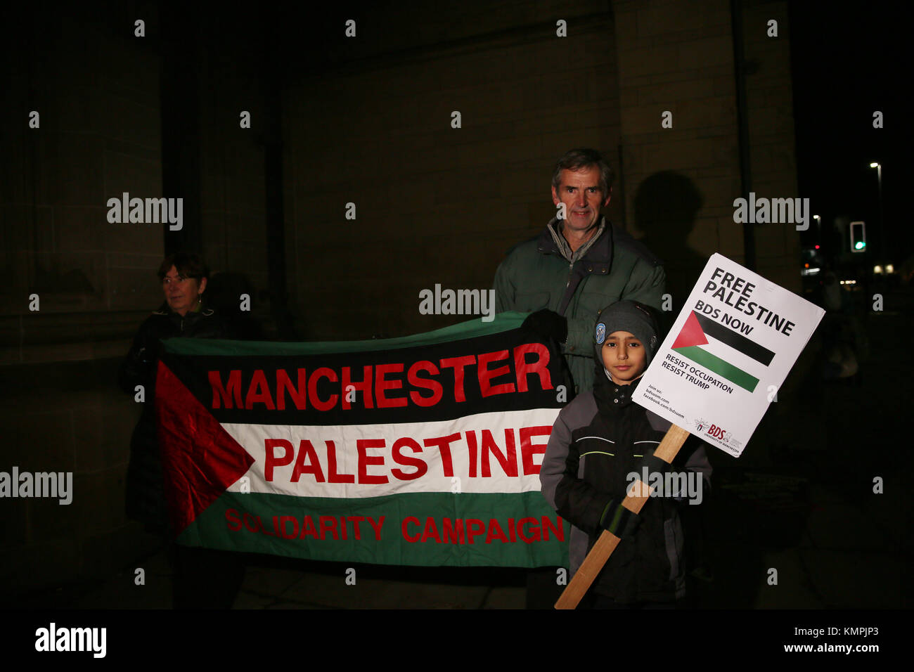 Manchester, UK. 8th December, 2017. Manchester Palestine Solidarity Campaign banner is held up outside the University - Stock Image