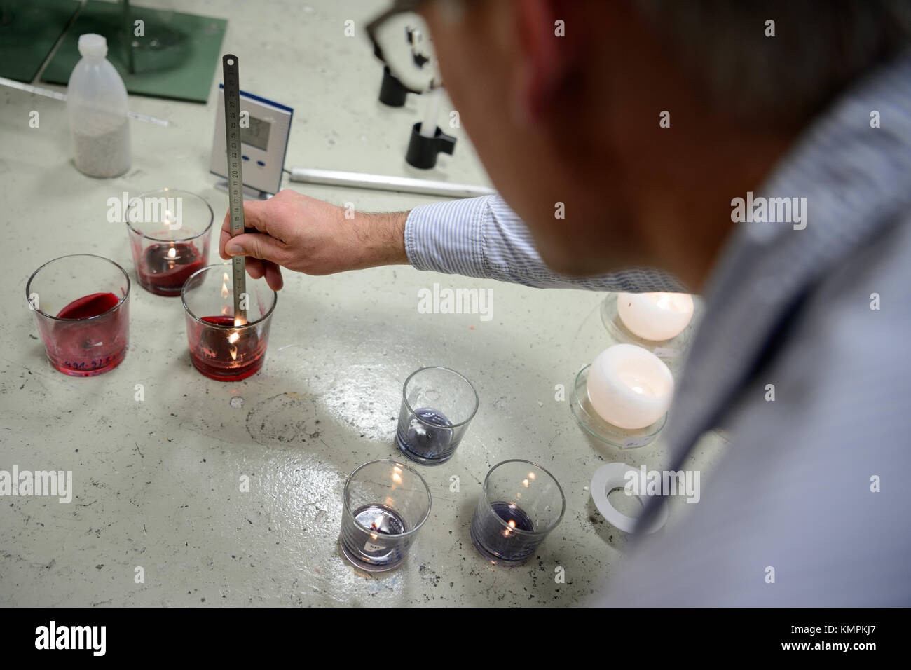 Stuttgart, Germany. 5th Dec, 2017. Candle tester Volker Albrecht measures the height of a candle's flame, in Stuttgart, Stock Photo