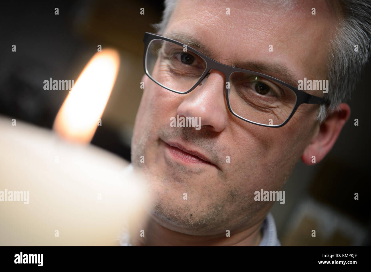 Stuttgart, Germany. 5th Dec, 2017. Candle tester Volker Albrecht looking at a candle's flame, in Stuttgart, Germany, Stock Photo
