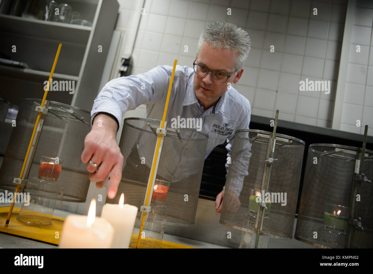Stuttgart, Germany. 5th Dec, 2017. Candle tester Volker Albrecht points to a candle's flame, in Stuttgart, Germany, Stock Photo