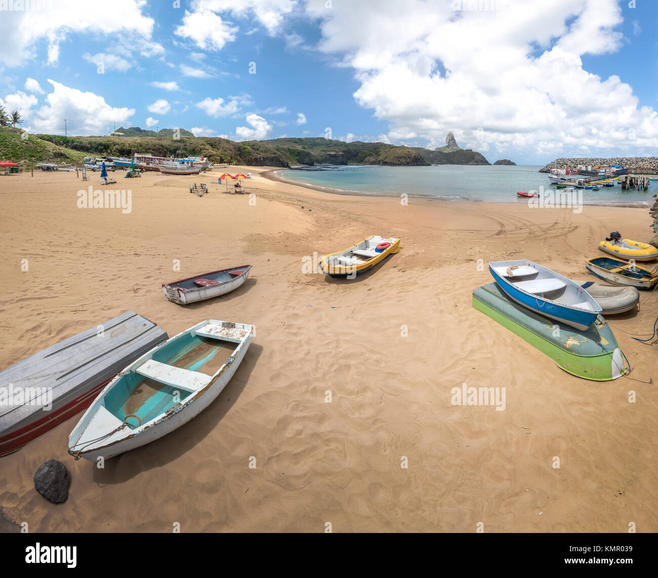 Boats at Praia do Porto Beach and Santo Antonio Port with Morro do Pico on background - Fernando de Noronha, Pernambuco, - Stock Image