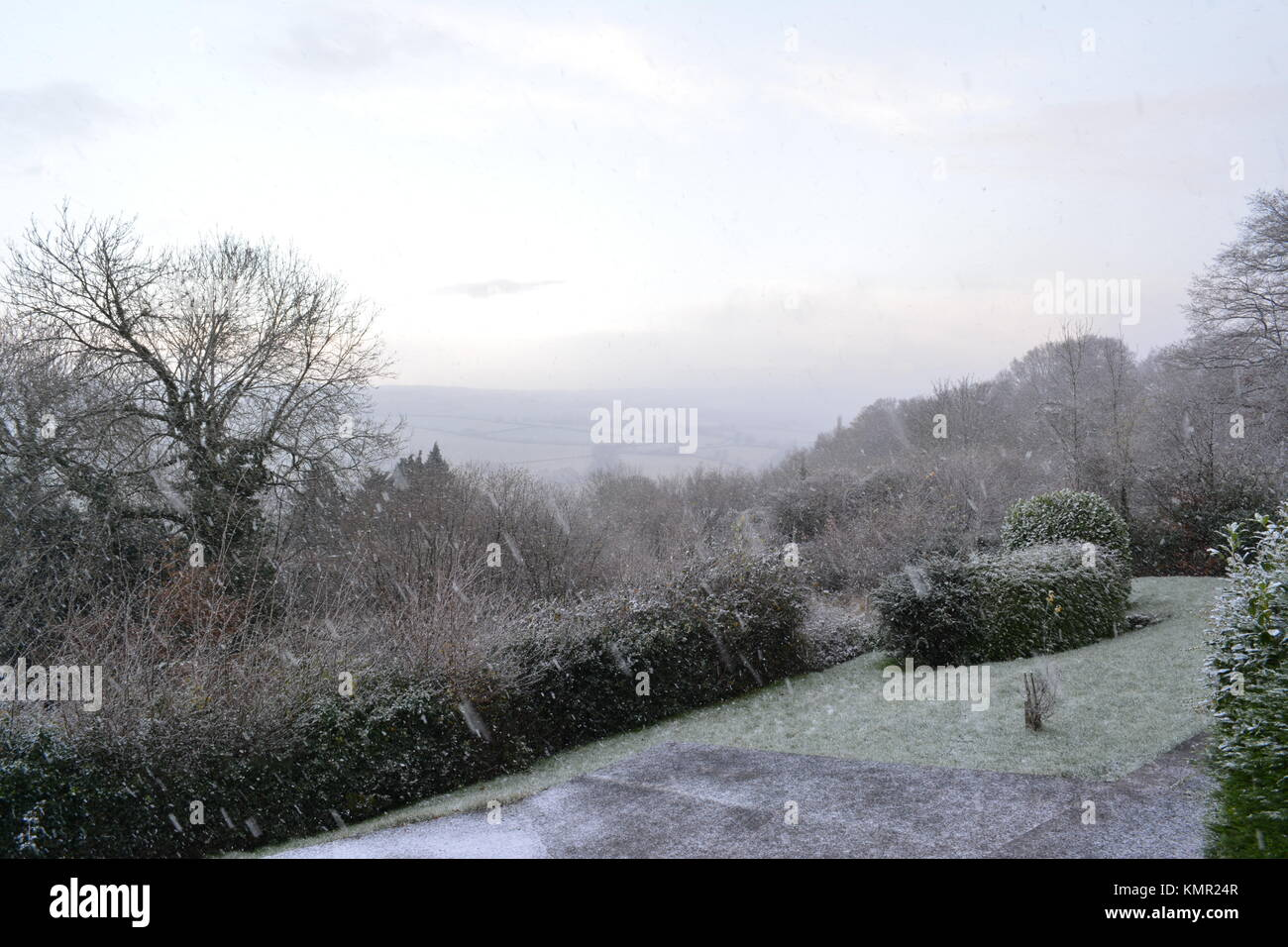 Winter country view with slight snow fall cover from hill side looking towards fields and open countryside  in South - Stock Image