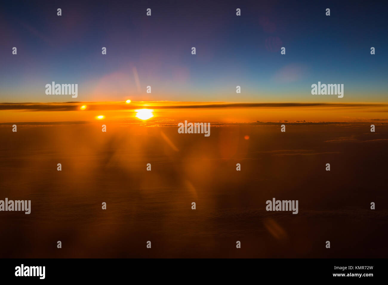 Sunrise over the sky - Sonnenaufgang über den Wolken - Flug in 12000 Meter - Stock Image