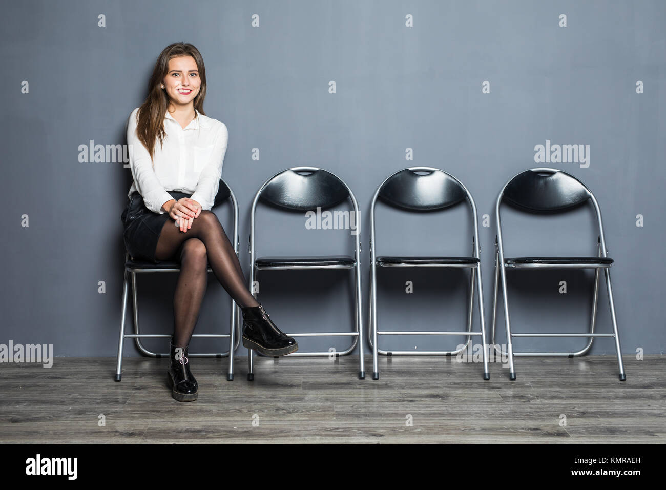 Young woman waiting for job interview in reception hall - Stock Image