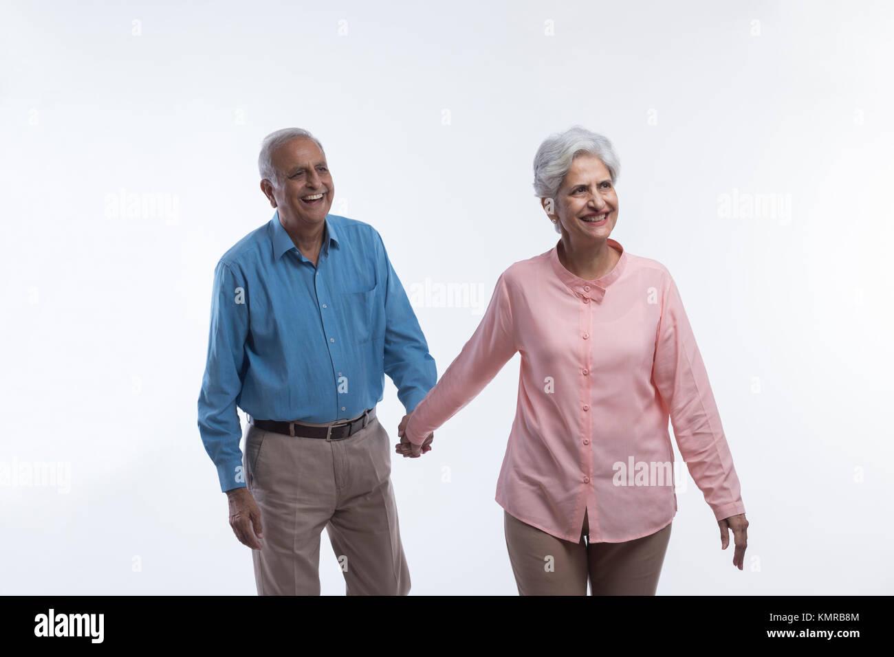 Senior couple holding hand Stock Photo