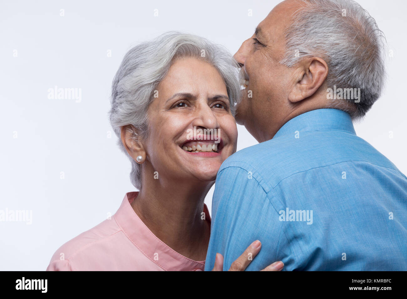 Close up of older couple embracing each other - Stock Image