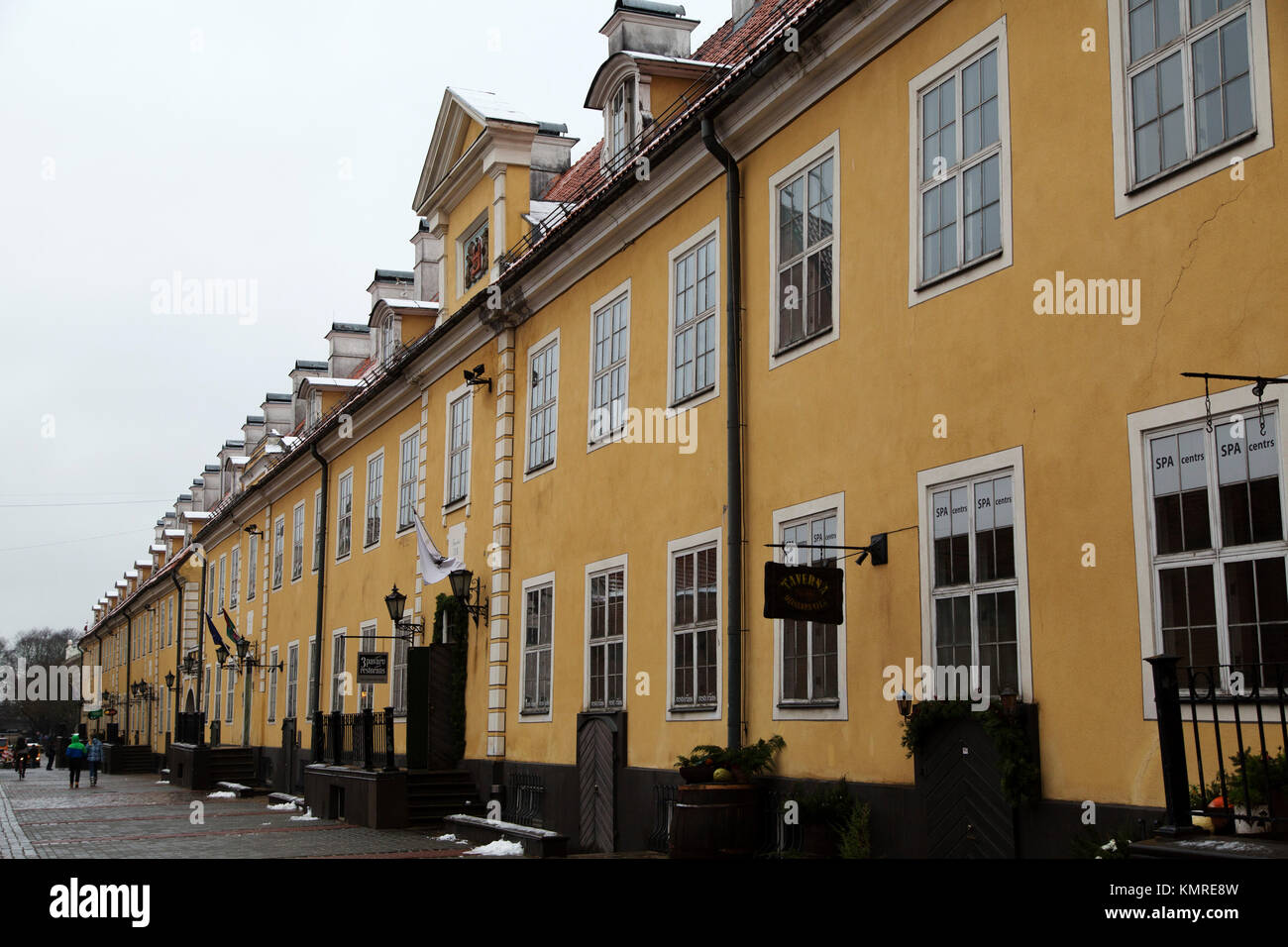 Yellow facades of buildings on Torna iela in Riga, Latvia. Businesses now occupy the buildings. - Stock Image
