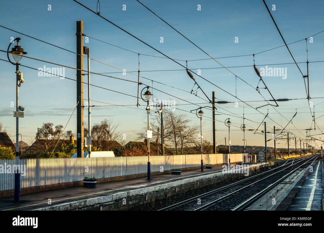 Wet winter morning looking down railway tracks, Drem Station, East Lothian, Scotland, UK, unmanned rural ScotRail - Stock Image