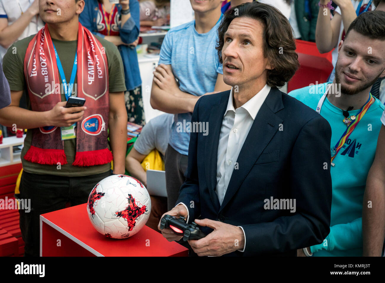 Ambassador of the World Cup 2018 in Russia football player Alexei Smertin plays a computer game FIFA2018 in the - Stock Image