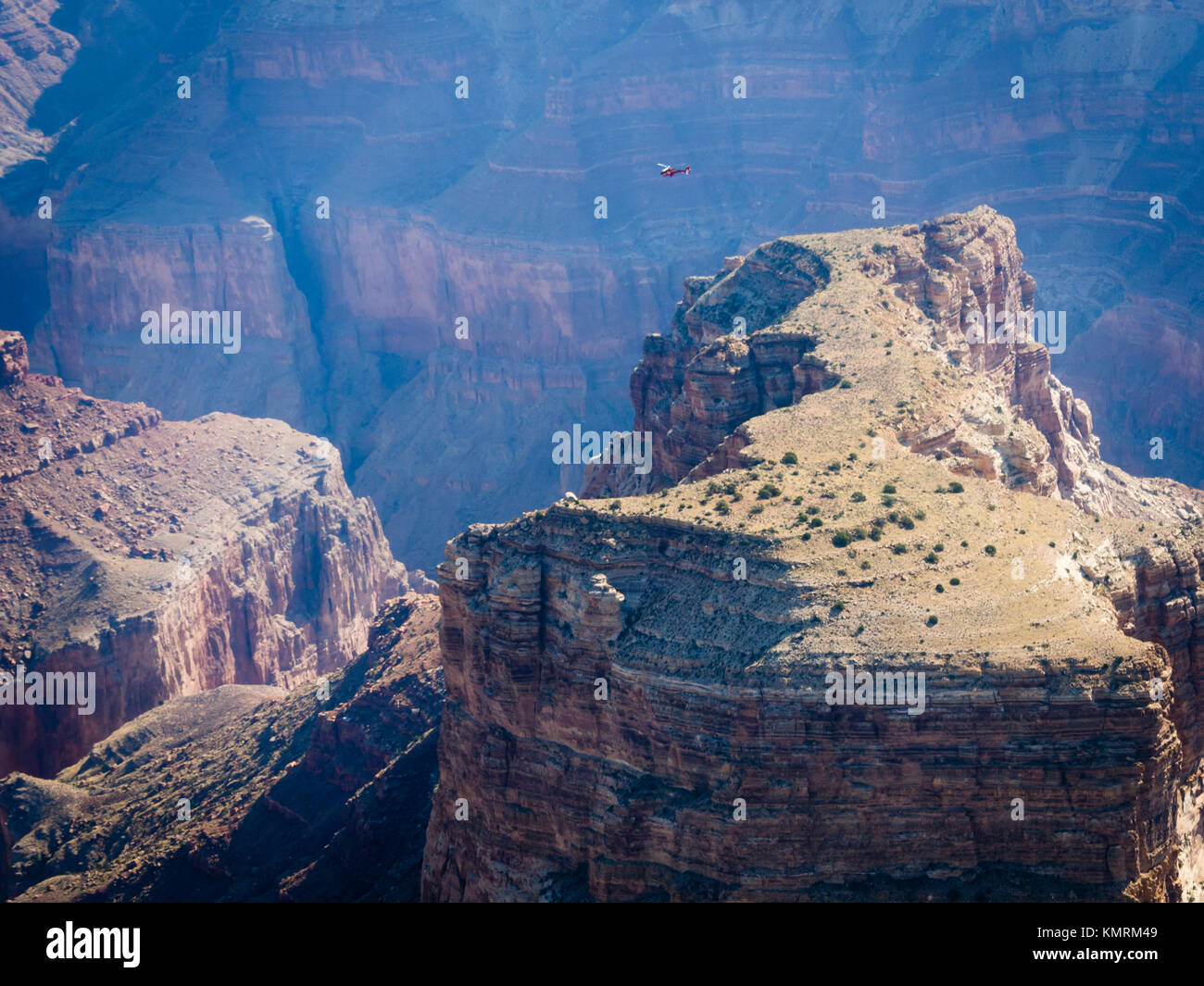 A helicopter durng a sightseeing flight at the Grand Canyon National Park. - Stock Image
