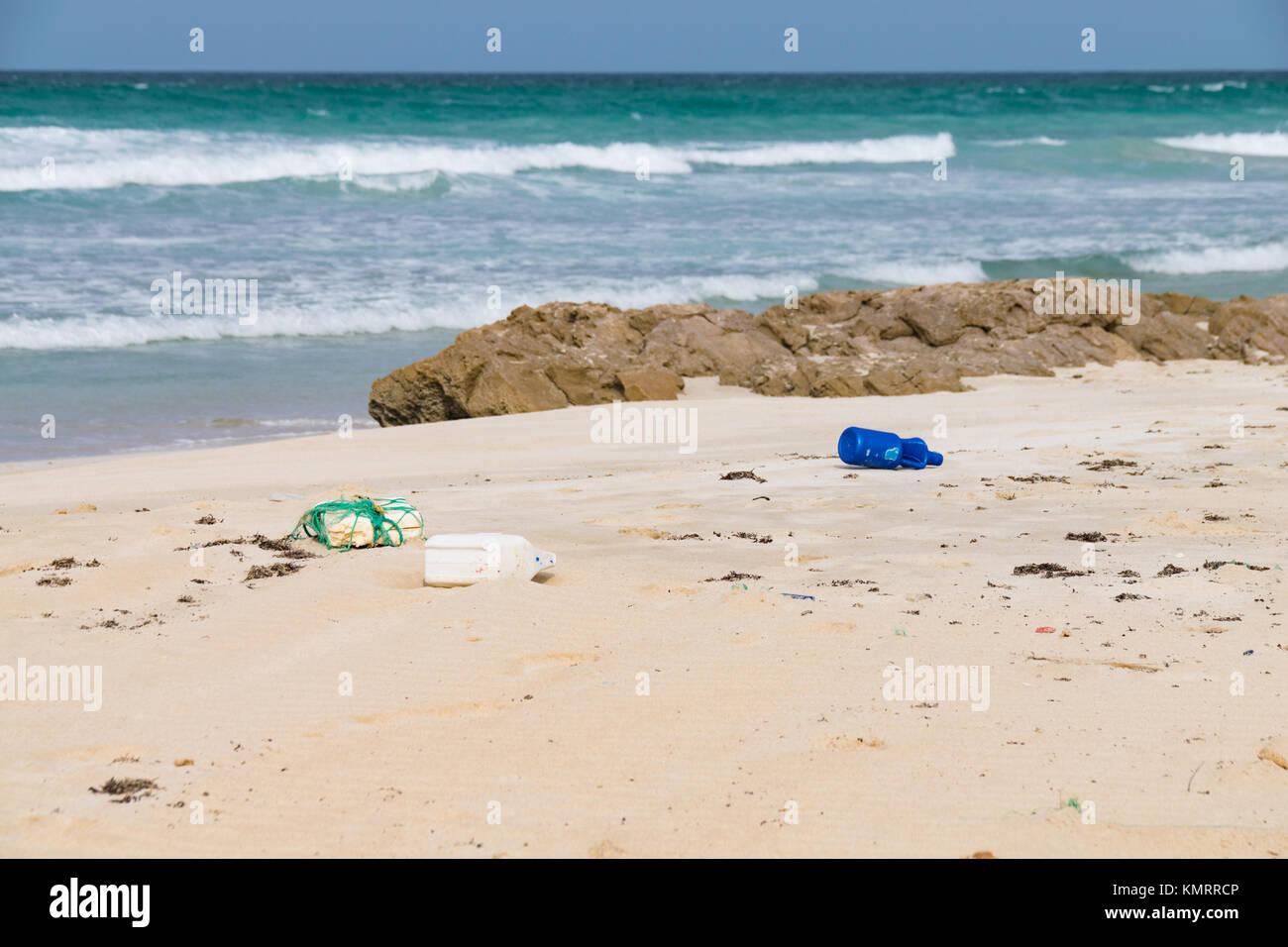 Plastic and discarded rubbish brought in by the Atlantic Ocean on Santa Maria Beach, Boa Vista Cape Verde - Stock Image