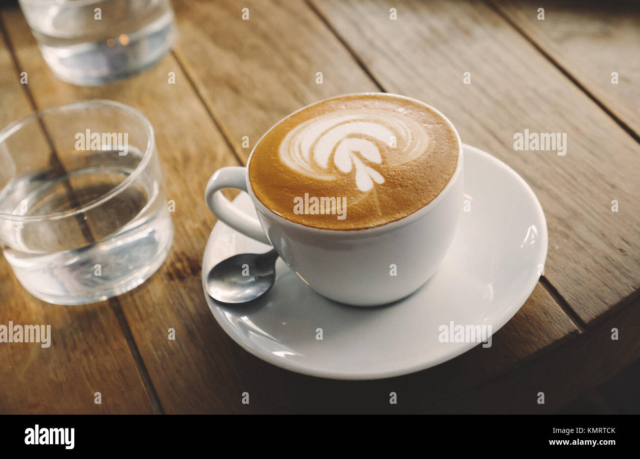 Closeup of barista made coffee with froth art - Stock Image