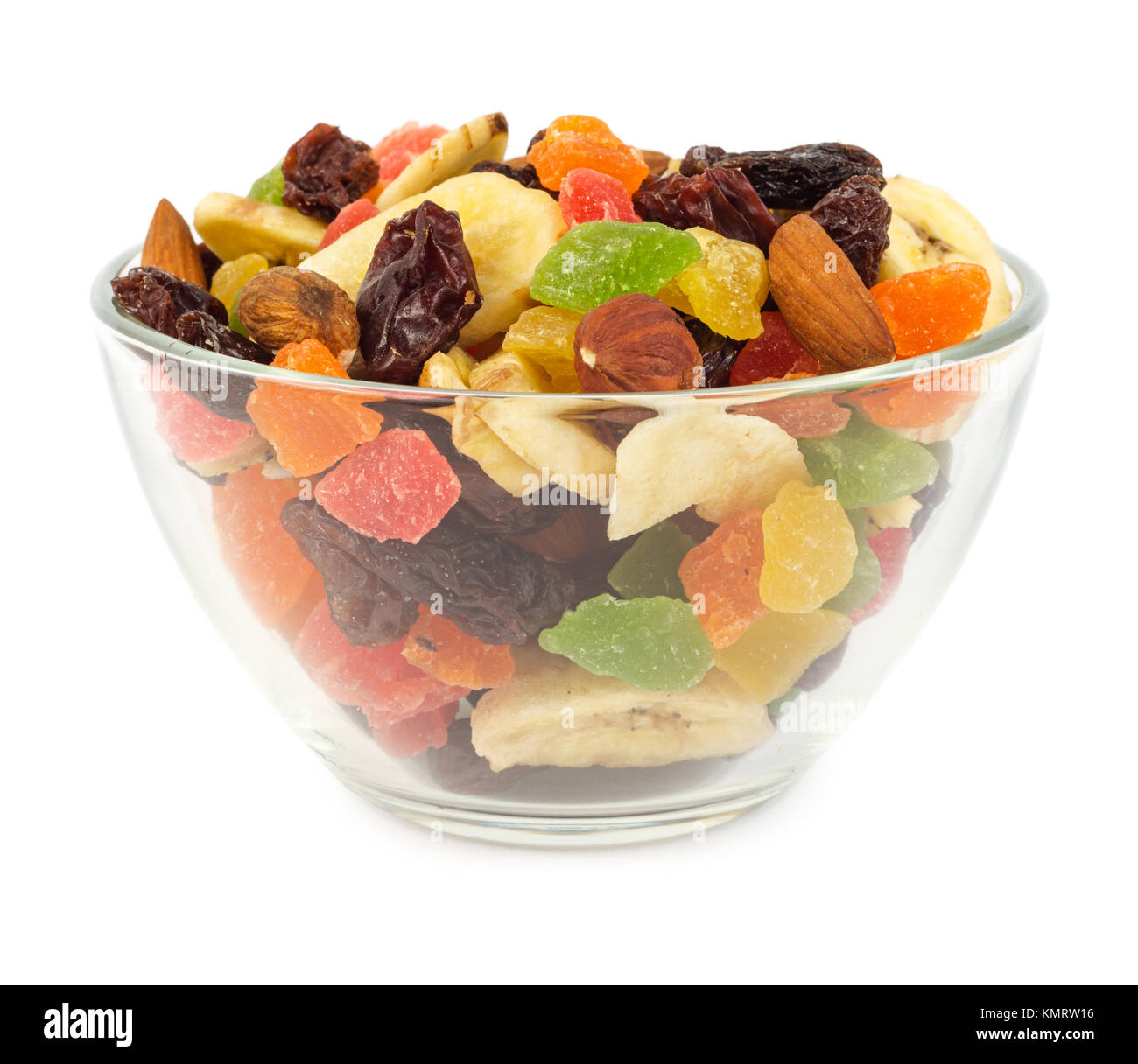 Dried fruits in glass bowl isolated on white background - Stock Image
