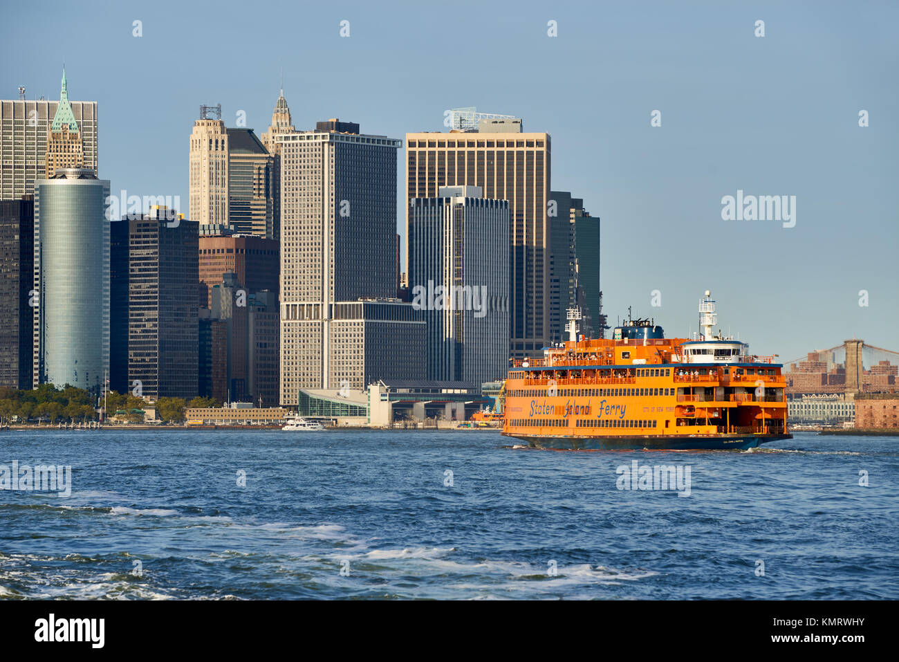 Financial District skyscrapers and the Staten Island Ferry. Lower Manhattan, New York City Harbor - Stock Image