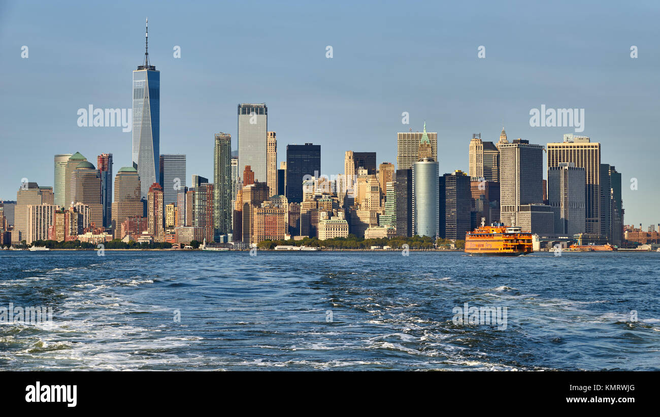 Panoramic view on the Financial District skyscrapers (One World Trade Center) with the Staten Island Ferry. Lower - Stock Image