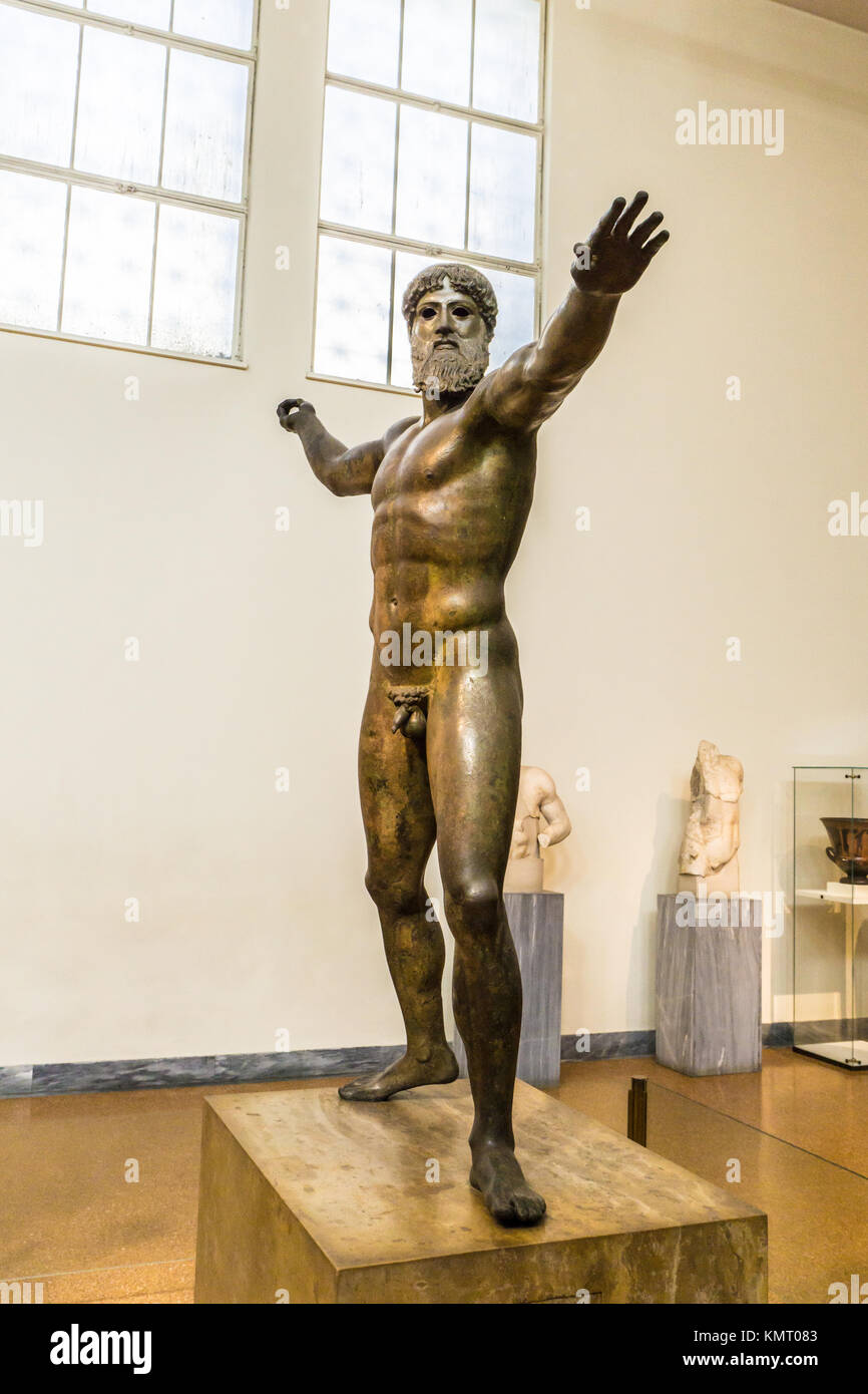 Bronze statue of Zeus or Poseidon in archaeological museum in Athens - Stock Image