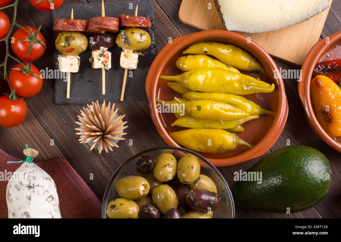 Sharing mixed spanish tapas starters on table. Top view - Stock Image