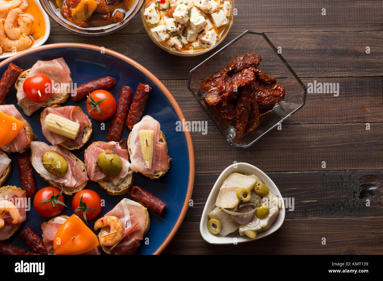 Sharing mixed spanish tapas starters on table. Top view. Copyspace - Stock Image