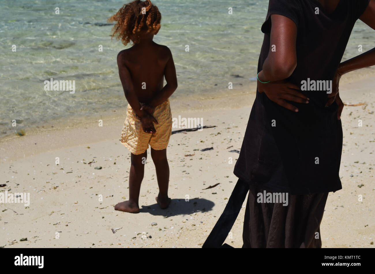 Mother and child by the water - Stock Image
