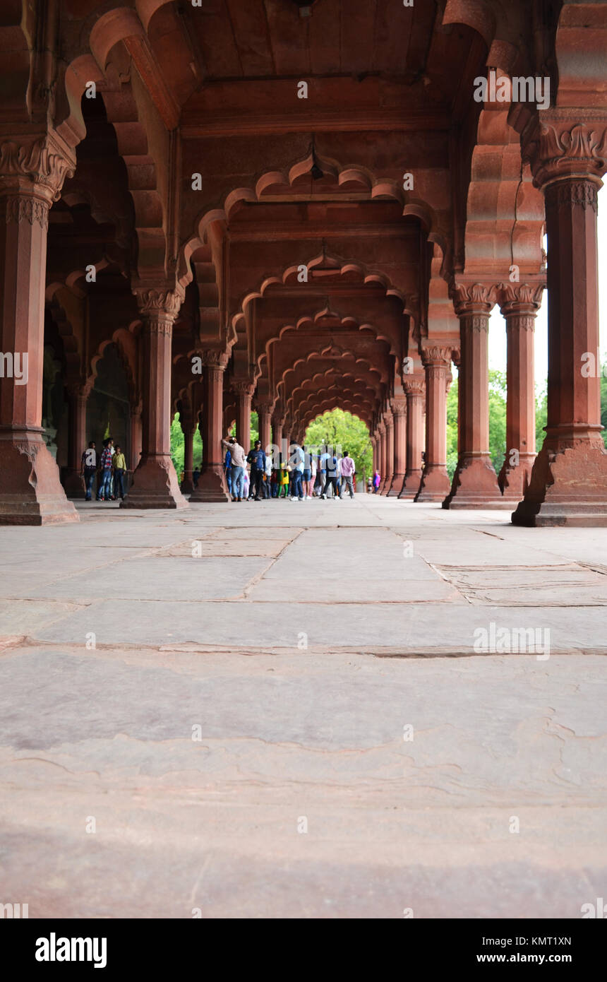 Tiny little people. Photo at Red Fort New Delhi Indian taken with perspective close to ground highlighting arches - Stock Image
