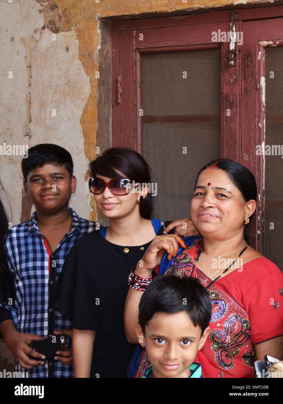 Happy smiling family enjoying their day together, taken at Red Fort in New Delhi India. - Stock Image