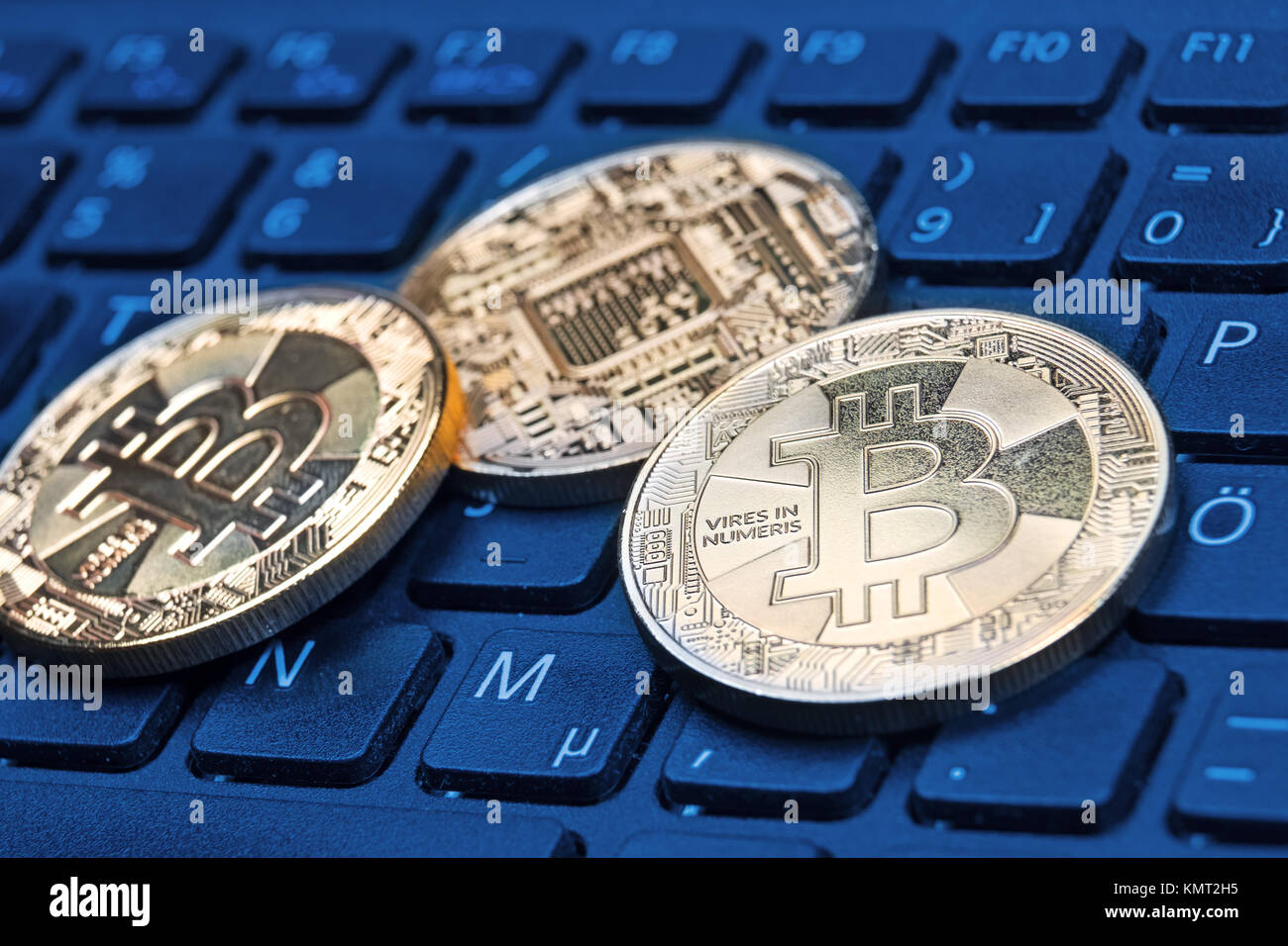 Gold-colored Bitcoin cryptocurrency coin on a computer keyboard Stock Photo