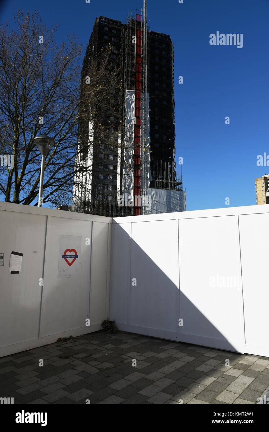 Burnt Grenfell Tower is being covered in a protective wrap - Stock Image