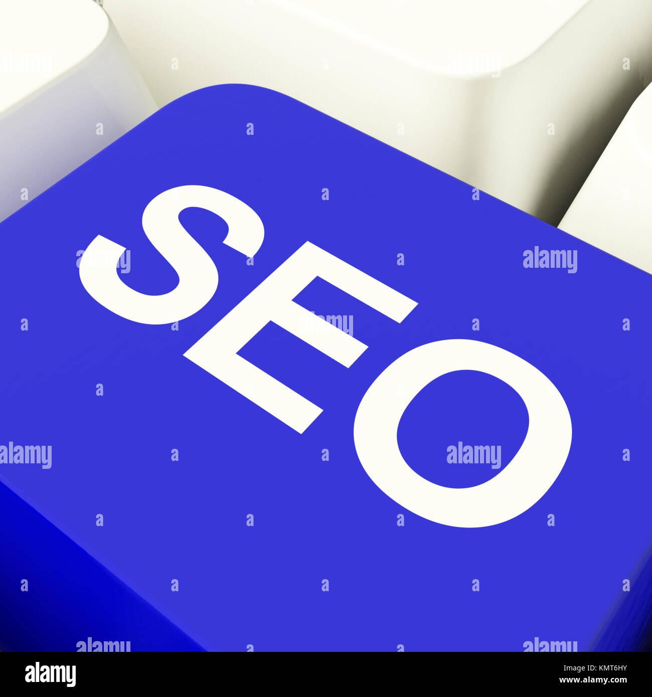 SEO Computer Key In Blue Showing Internet Marketing And Optimisation - Stock Image