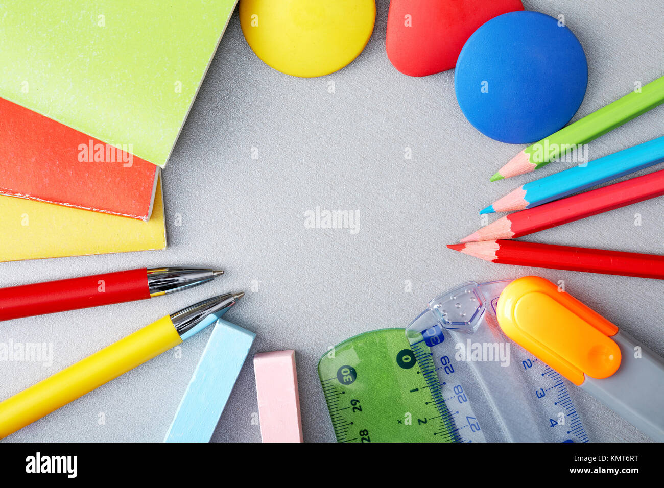 Circle of pens, pencils, chalks, rulers and exercise books - Stock Image