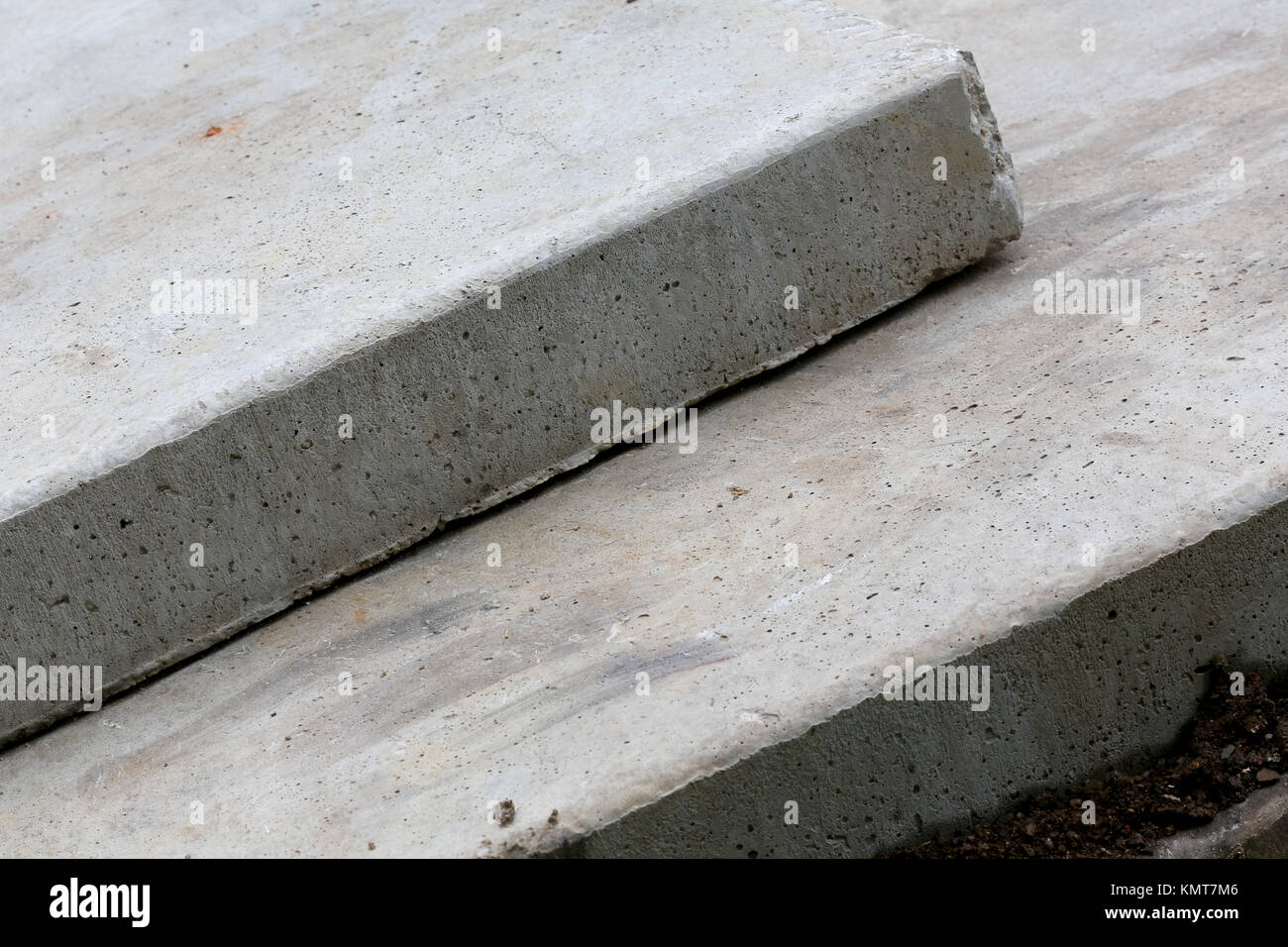 Two concrete slabs were placed one on top of each other. These are large structural elements usually used in the - Stock Image