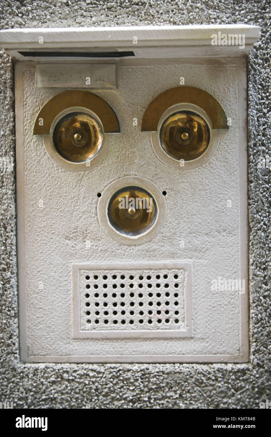 Apartment intercom in form of a face. Venice. Italy - Stock Image