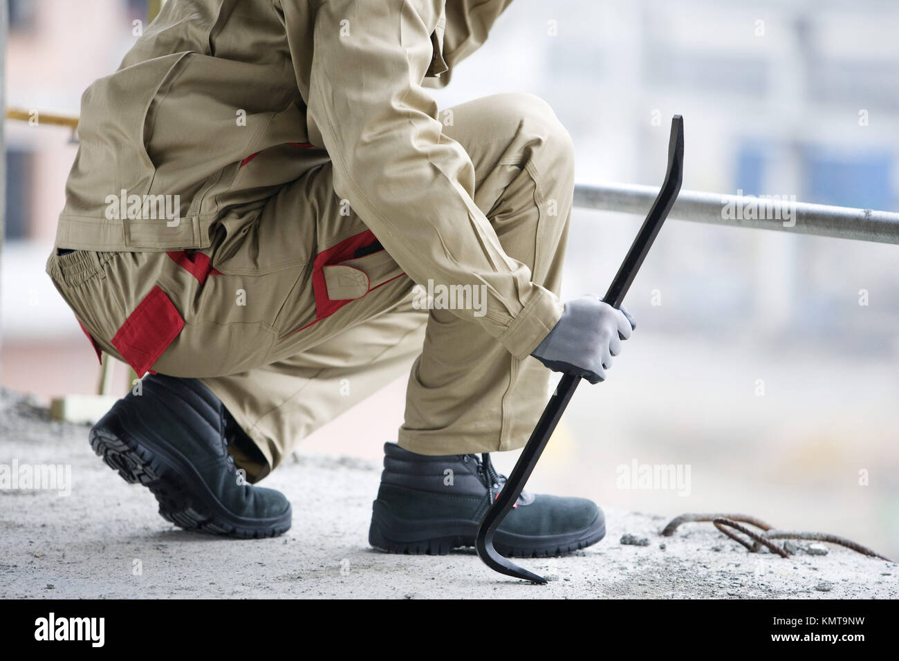 Workers with stripping bar, housing construction Stock Photo
