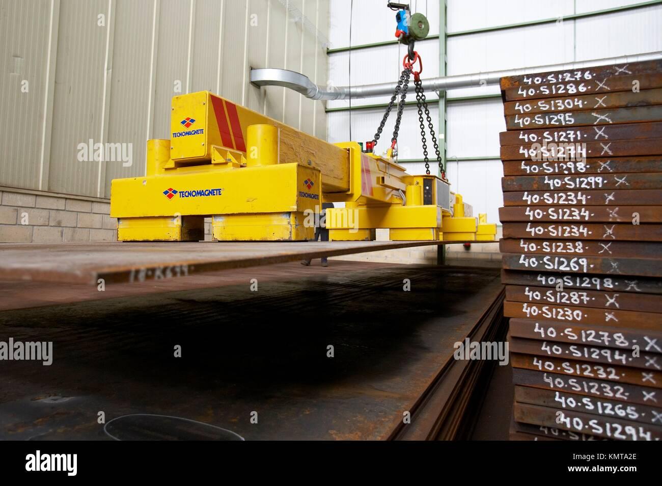 Telescopic electromagnetic crane for handling large steel plates Stock Photo