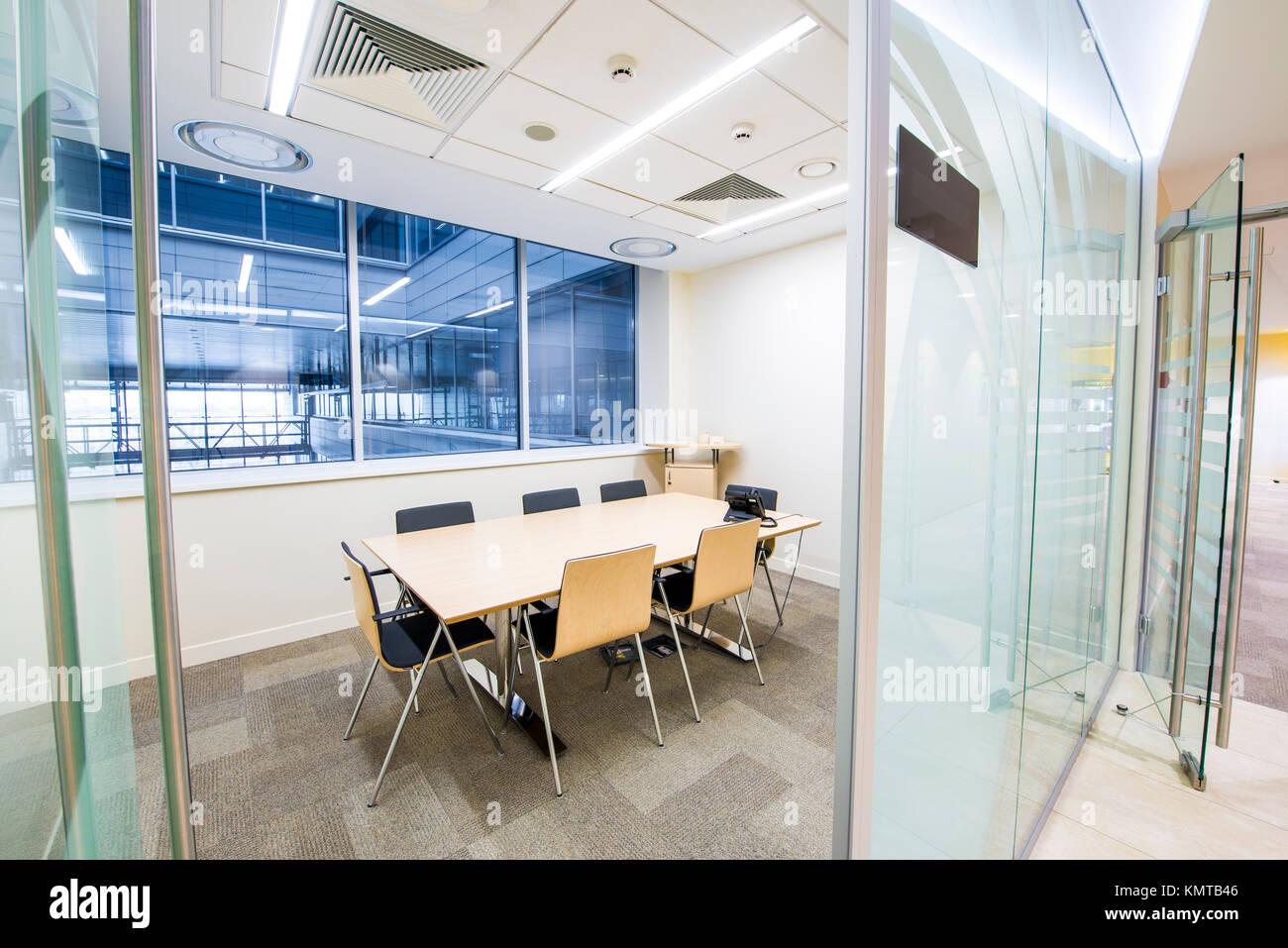 Empty small meeting room. Bright modern interior. Glass walls Stock Photo