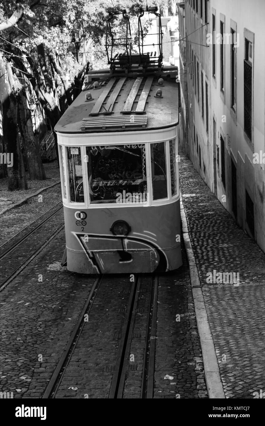 Traditional yellow funicular in the city center of Lisbon - Stock Image