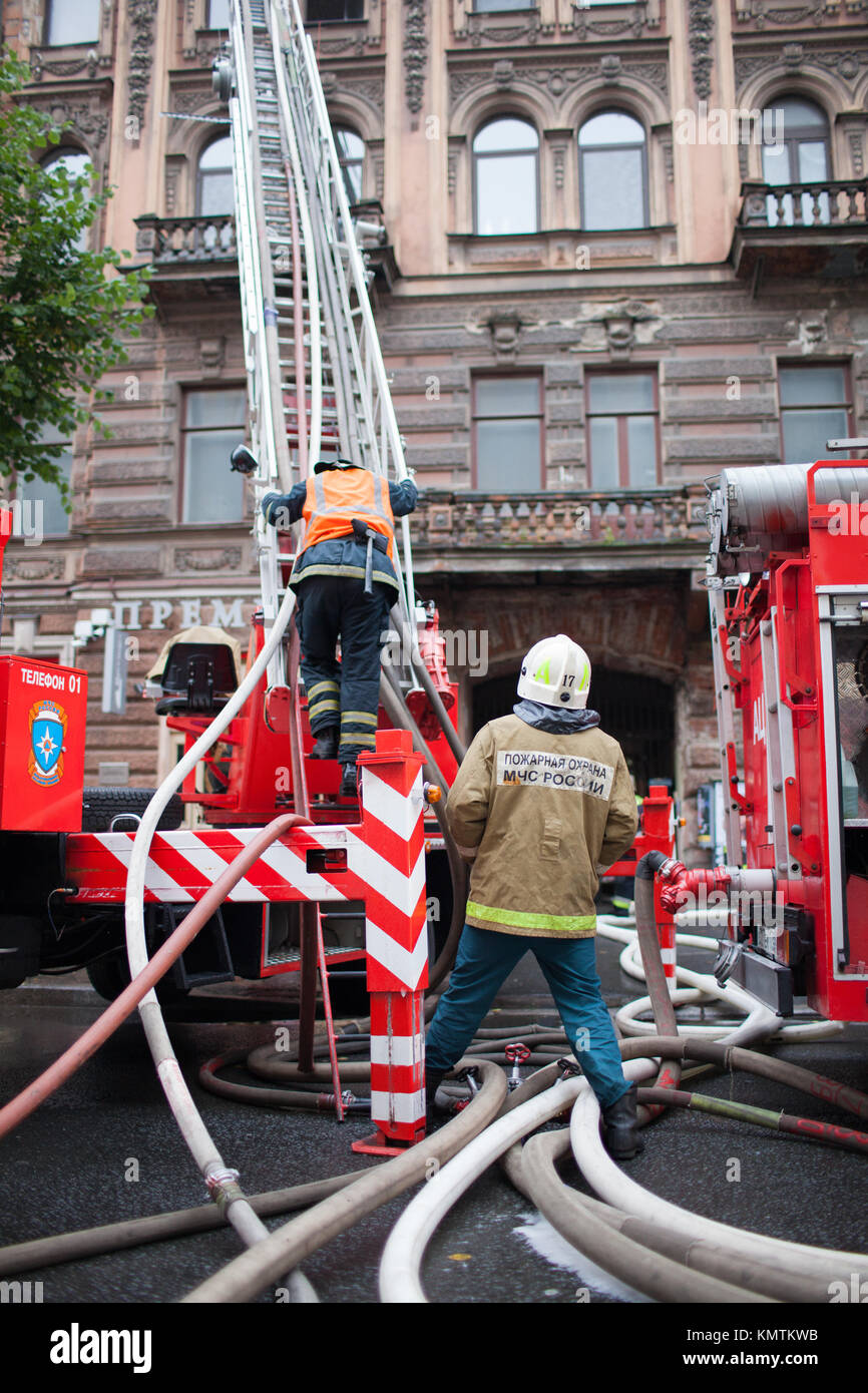 Saint Petersburg, Russia, on the morning of September 13, 2017. Firefighters extinguish a large fire on the roof - Stock Image