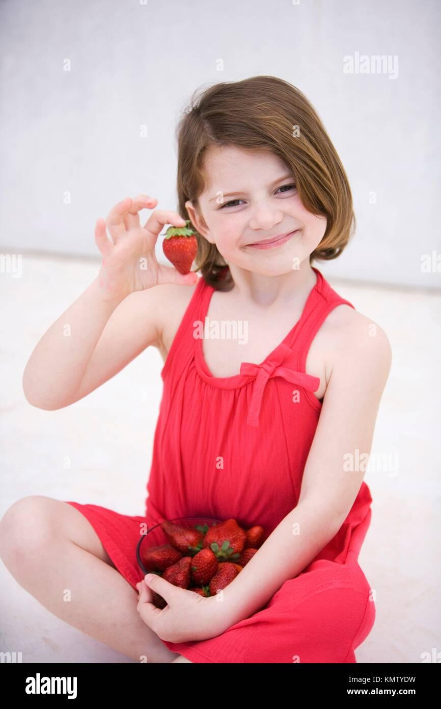 Caucasian girl showing nice strawberries Stock Photo