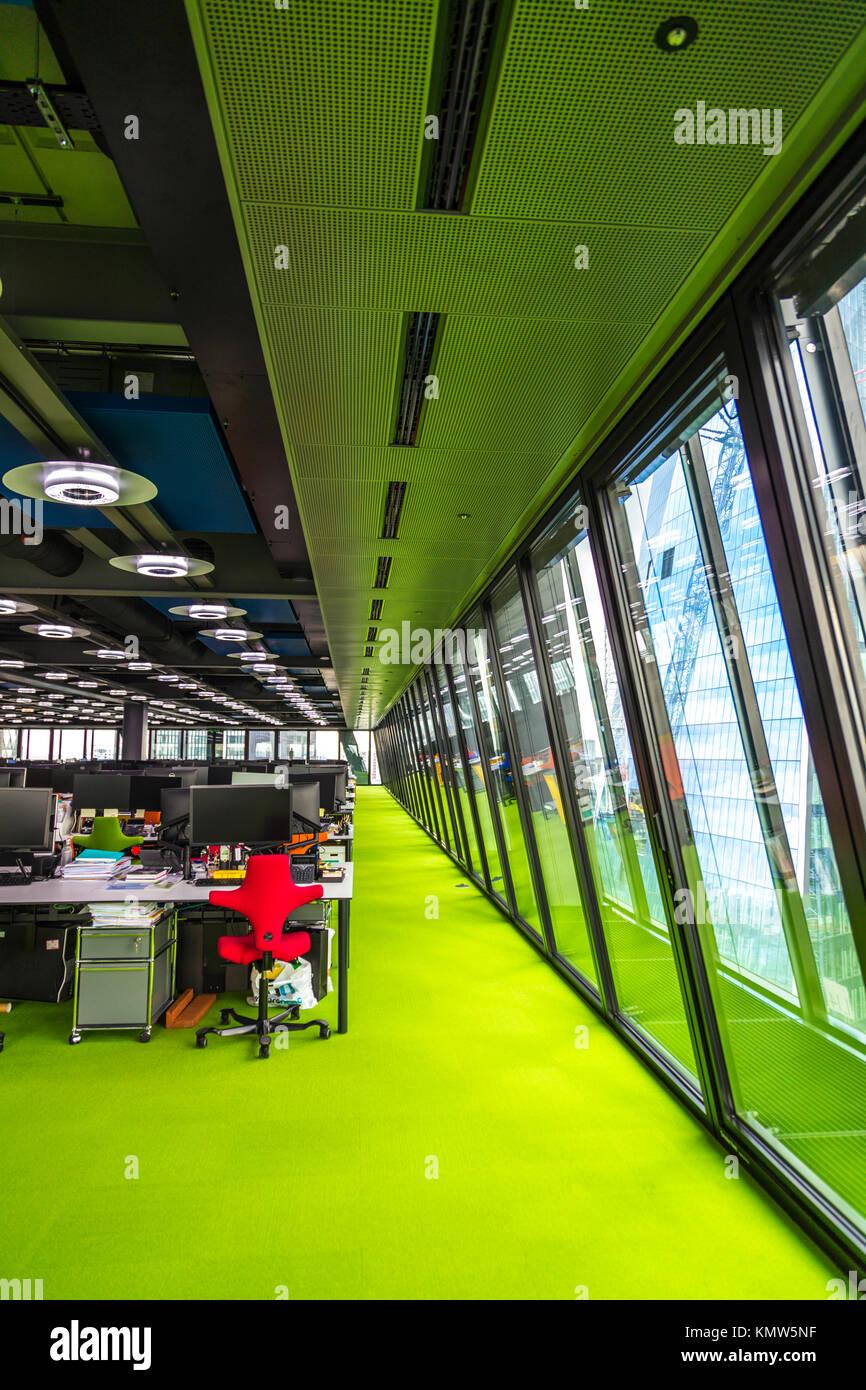 Colourful vibrant modern open plan office inside The Leadenhall Building, London, UK - Stock Image