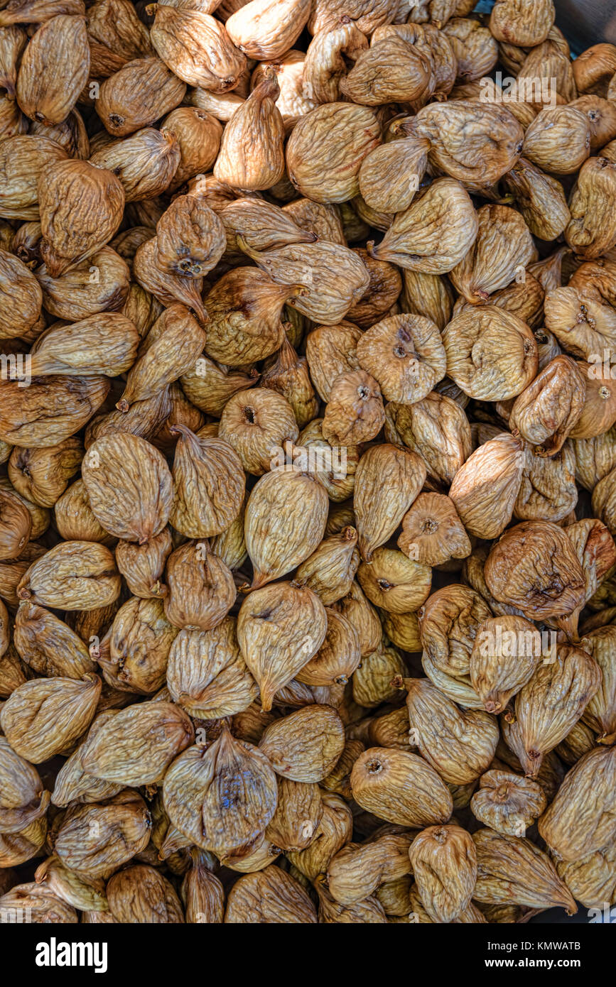 Cleaned dried figs sitting to be packaged - Stock Image