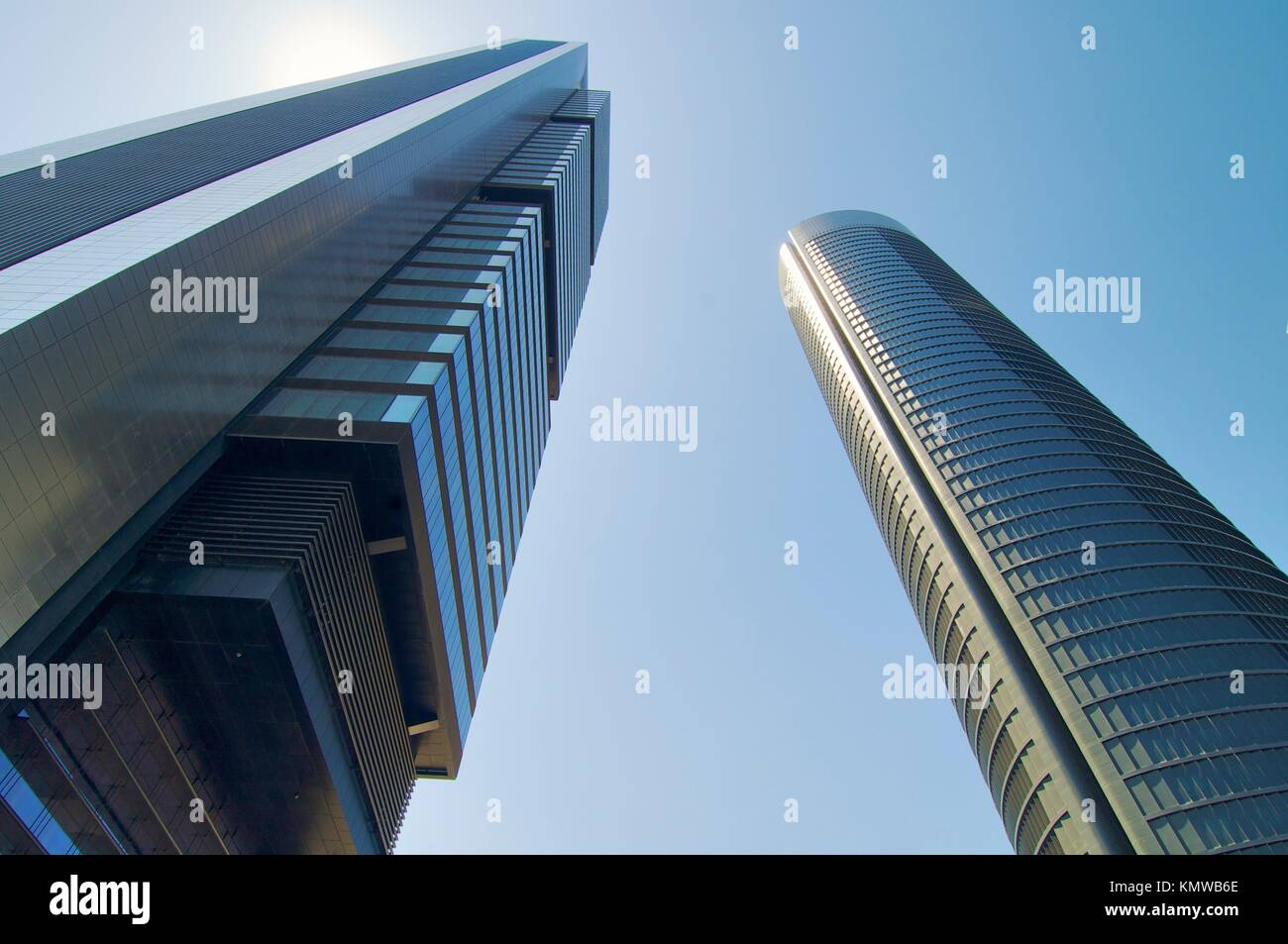 Two skyscrapers from below in Madrid, Spain - Stock Image