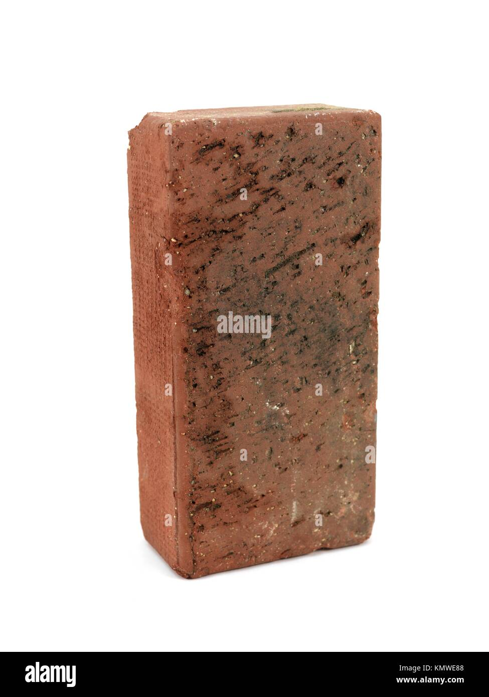 A red brick isolated against a white background - Stock Image