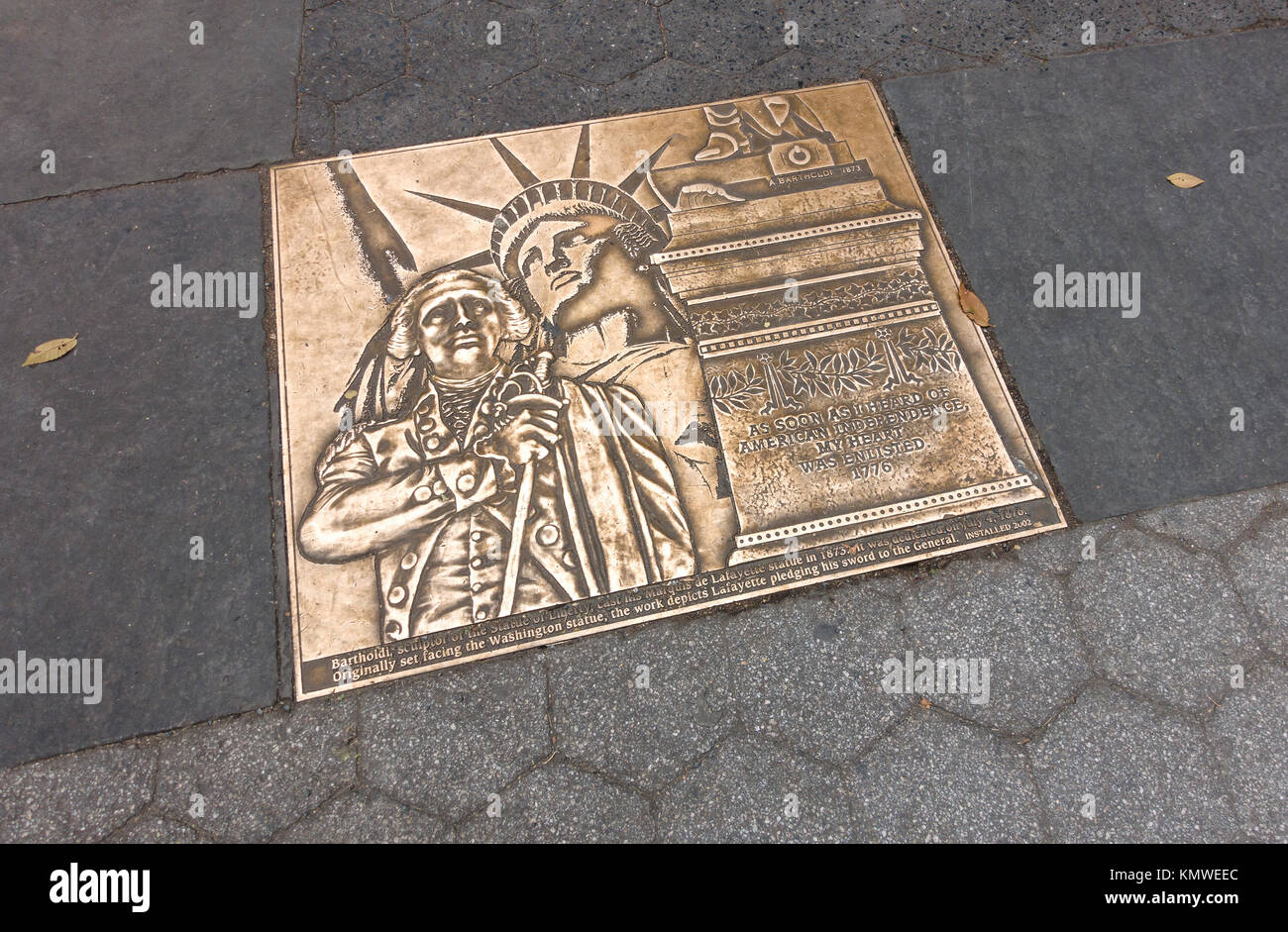 Golden colored plaque set in the grounds at Union Square, New York City, honoring Marquis de Lafayette for his help - Stock Image
