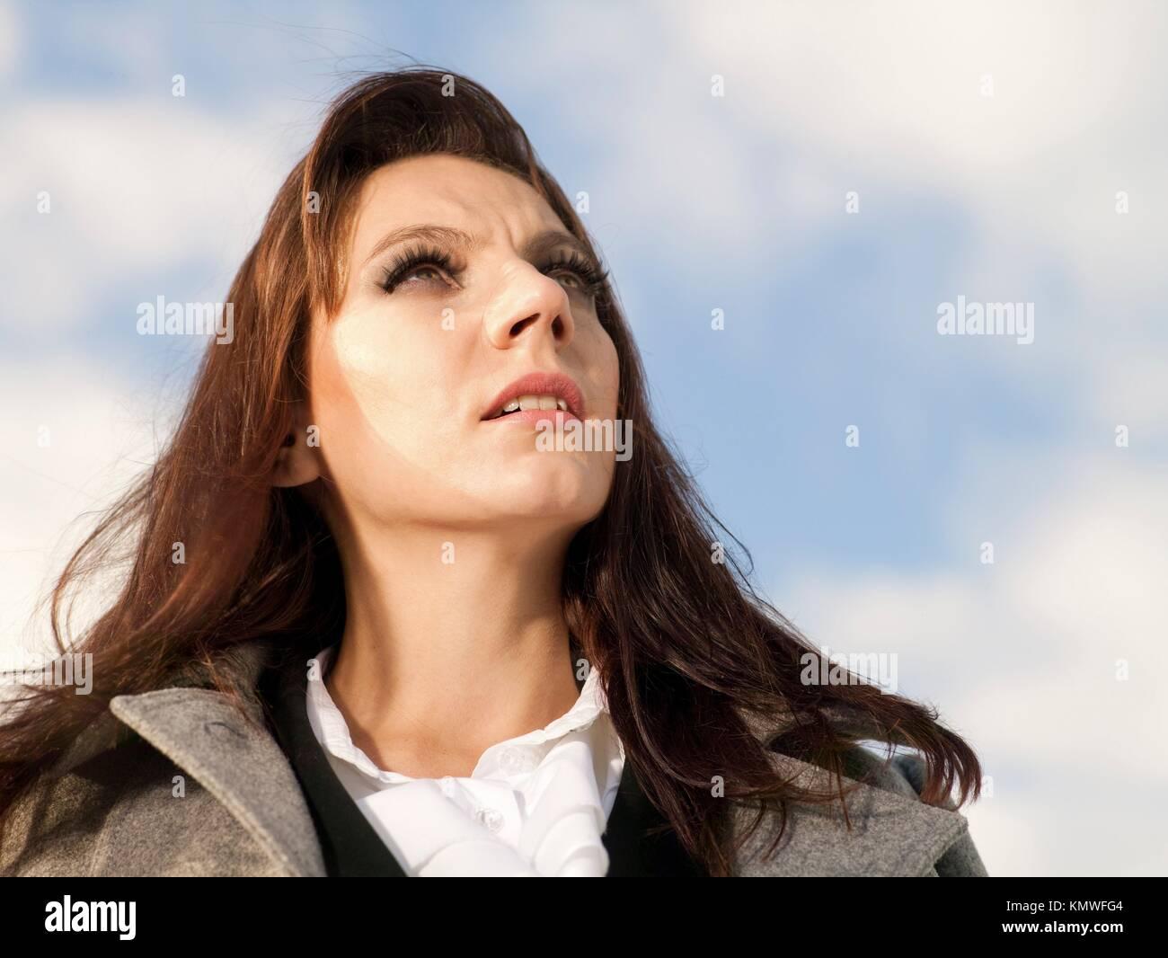 melancholy woman´s portrait under the blue skies - Stock Image