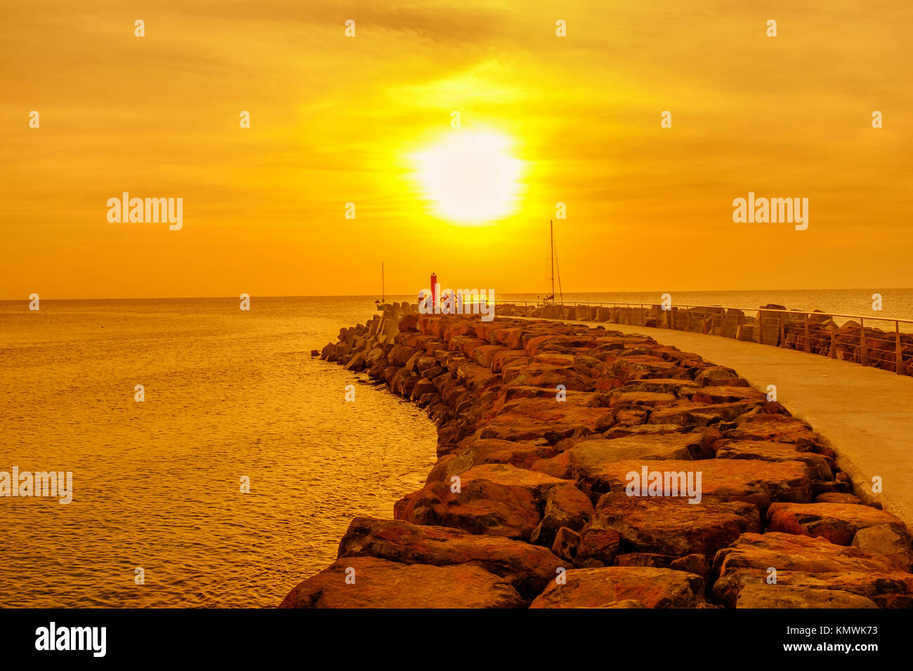 Sunset over the pier at Bikini Beach, Cape Verde, Africa - Stock Image
