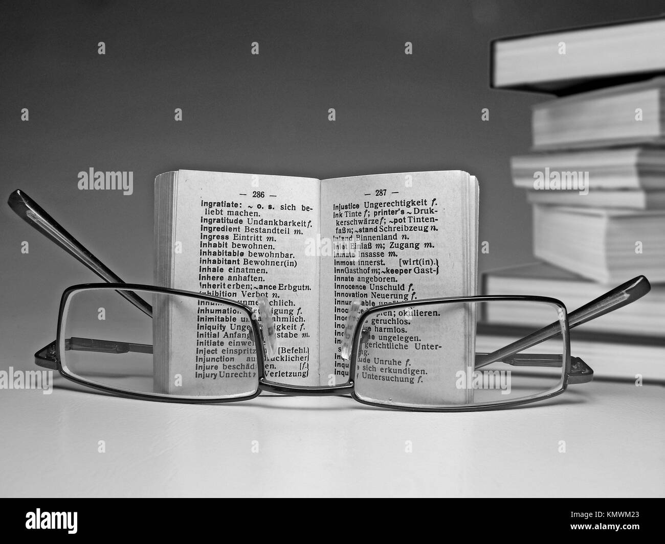 Spectacle on an opened dictionary - Stock Image