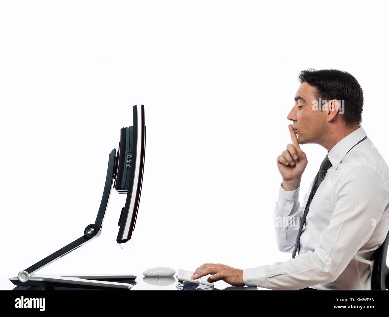 relationship between a caucasian man and a computer display monitor on isolated white background expressing secrecy - Stock Image