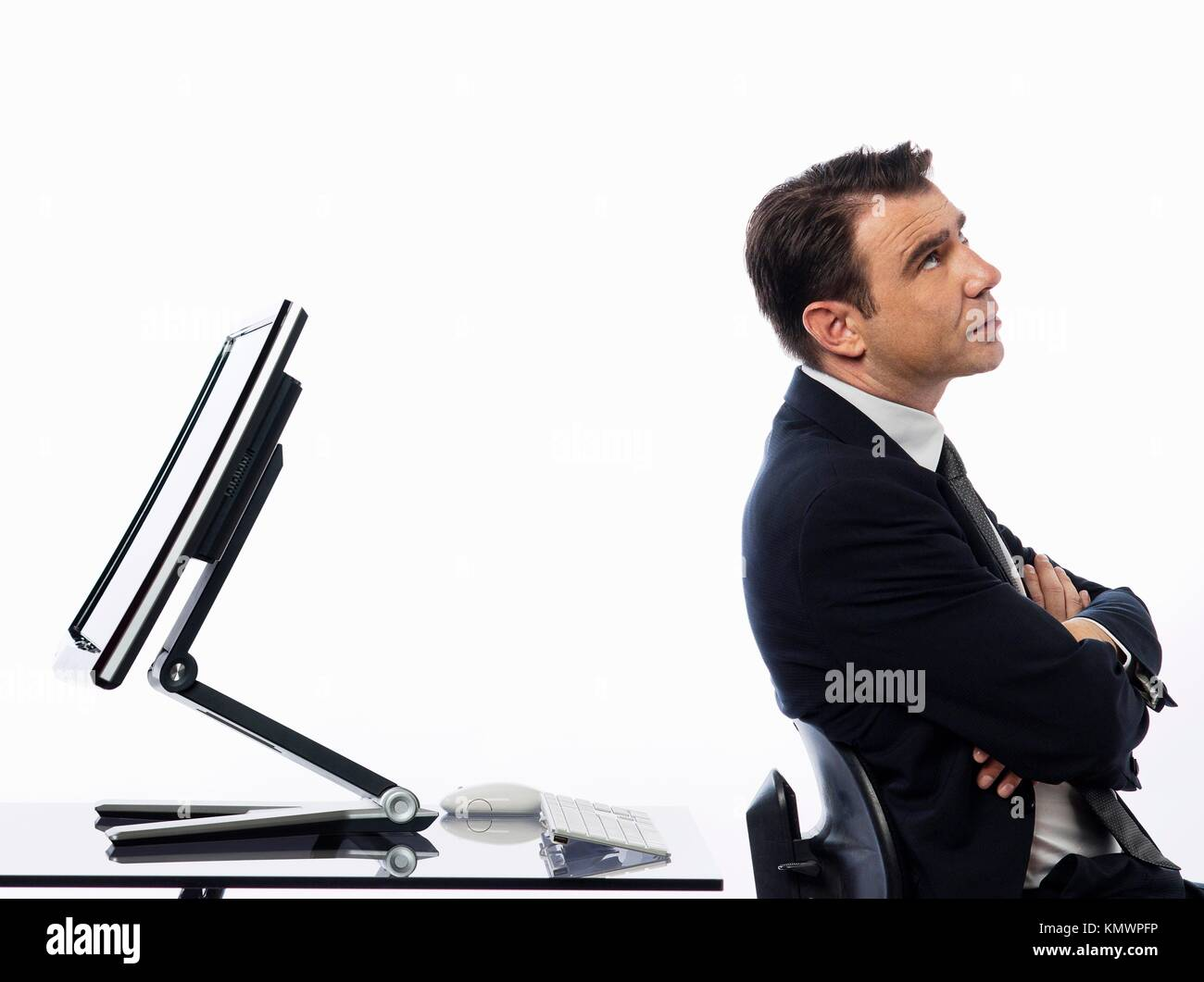 relationship between a caucasian man and a computer display monitor on isolated white background expressing conflict - Stock Image