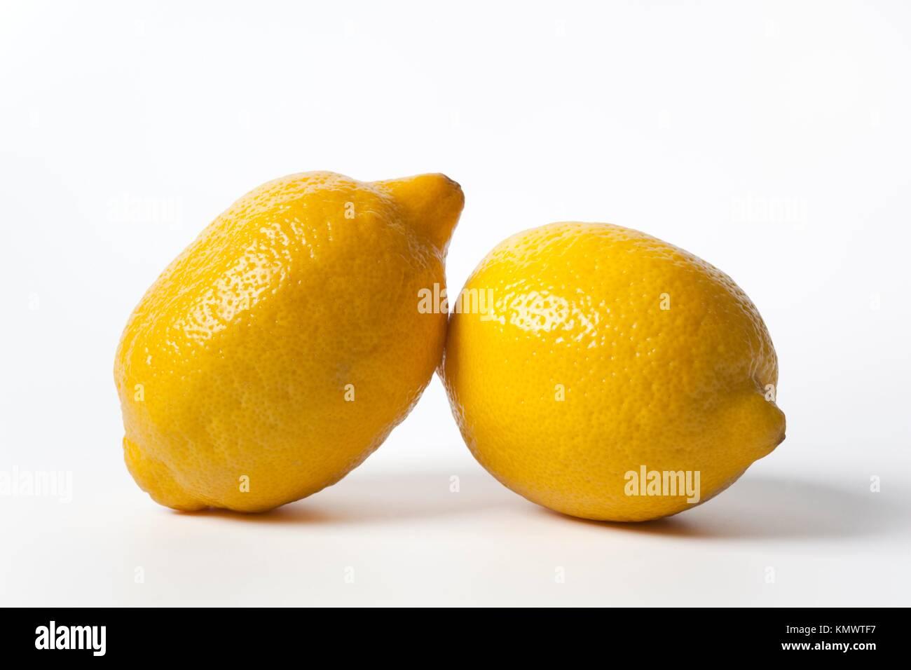 Two whole uncut lemons - Stock Image