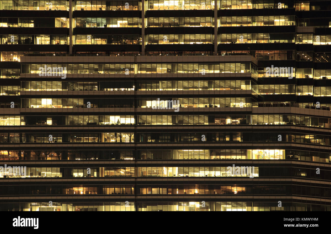 office building at night. Late night at work. Glass curtain wall office building Stock Photo